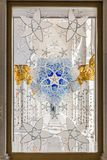 Abu Dhabi, United Arab Emirates, December 16, 2015: Ornate window design in the Sheikh Zayed Grand Mosque. Ornate window design in the interior of the Sheikh royalty free stock images