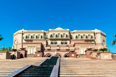Abu Dhabi, United Arab Emirates - December 13, 2018: Staircase with a stream and the facade of the famous Palace of the Emirates stock photography