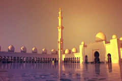 Abu Dhabi, United Arab Emirates -MARCH 22, 2017:Domes and minaret at sunset in Sheikh Zayed Grand Mosque Stock Photos