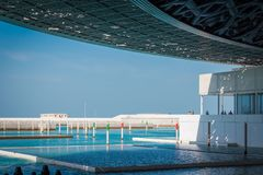 Abu Dhabi, United Arab Emirates, November 14, 2017: Louvre Abu Dhabi. Boat dock outside the Louvre, Abu Dhabi, enabling access to the museum by sea Stock Image