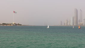 Abu dhabi water sport boat ride city view 4k uae flag stock video