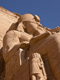 Abu Simbel. MW Pharaohs at the entrance of Abu Simbel temple in the Egyptian desert Royalty Free Stock Photography