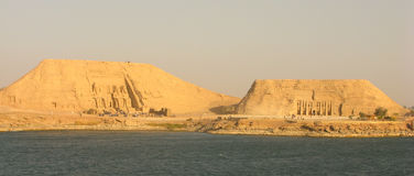 Abu Simbel Panorama. The twin monuments of Abu Simbel, Egypt, seen from Lake Nasser Stock Image