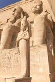 Abu Simbel. Statue of King Ramses II. Abu Simbel. View of the statue of King Ramses II. and his wife, Queen Nefertari. Bottom view shows the colossal size of Stock Photo