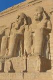 Abu Simbel Temple (Egypt). Sculptures of King Ramses II and queen Nefertari in Abu Simbel Temple (Egypt Royalty Free Stock Photos