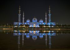 A night view of Sheikh Zayed Grand Mosque from a water reflectio royalty free stock images