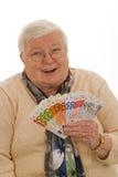 Abuela con euros fotos de archivo