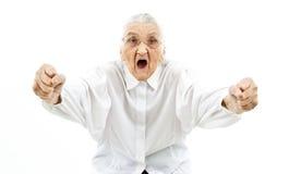 Abuela divertida como partidario Foto de archivo