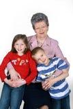 Abuela con los nietos Fotografía de archivo