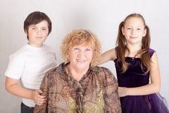 Abuela feliz con los nietos Imagen de archivo libre de regalías