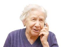 Abuela que habla con un teléfono móvil Imagen de archivo