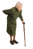 Abuela que sostiene un bastón en el fondo blanco Imagen de archivo