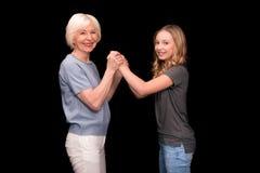 Abuela y nieta que llevan a cabo las manos Fotos de archivo libres de regalías