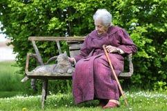 Abuela y su animal doméstico Fotografía de archivo libre de regalías