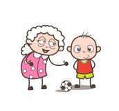 Abuelita de la historieta que juega a fútbol con el ejemplo del vector del nieto Imagen de archivo libre de regalías