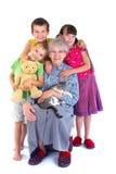 Abuelita y niños felices Imágenes de archivo libres de regalías