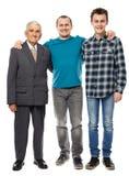 Abuelo, hijo y nieto aislados en blanco Fotos de archivo