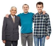 Abuelo, hijo y nieto aislados en blanco Foto de archivo libre de regalías