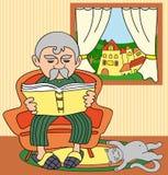 Abuelo que lee un libro Imagen de archivo libre de regalías