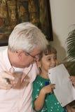 Abuelo y nieta Foto de archivo