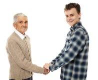 Abuelo y nieto que sacuden las manos Foto de archivo libre de regalías