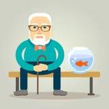 Abuelo y su pez de colores Imagen de archivo
