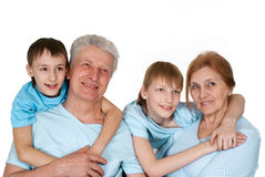 Abuelos caucásicos con los buenos niños Fotografía de archivo libre de regalías