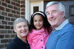 Abuelos con la nieta Imágenes de archivo libres de regalías