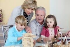Abuelos con los nietos Fotografía de archivo libre de regalías