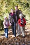 Abuelos y nietos en caminata Imagen de archivo libre de regalías
