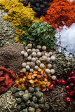 Abundance of different color spices. On steel plate Royalty Free Stock Images