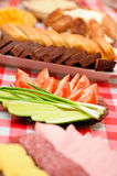 Abundance food. Cheese,sausage,bread, green onions,tomatoes, cucumbers,mashed potatoes, burgers background tablecloth Stock Photography
