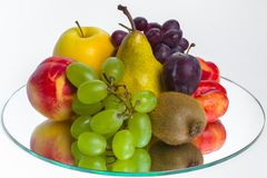 The abundance of fruit on a tray of glass Royalty Free Stock Photography