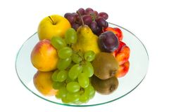 The abundance of fruit on a tray of glass Stock Images