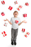 Abundance of Giifts Galore. A child in awe at the abundance of gifts falling around him like rain royalty free stock image