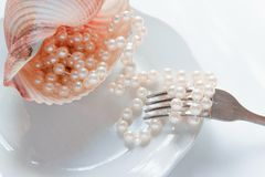 The abundance of life - precious necklace of pink pearls in the dish of destiny. Luxury lifestyle Royalty Free Stock Photography