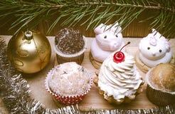 Abundance of pies under a fir and gold ball. Abundance of Christmas cakes under a fir Royalty Free Stock Image