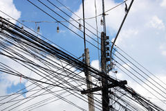 Abundance of Power Lines Connected to Wooden Poles Royalty Free Stock Photo
