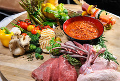 Abundance of raw food. On a wooden board royalty free stock image