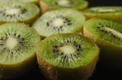 Abundance Rips fresh kiwis on black background/abundance Rips fresh kiwis on black background. selective focus. Abundance Rips fresh kiwis on black background/ stock photography