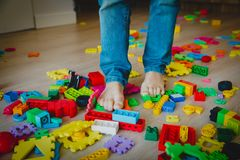 Too much toys at home- little boy steps on toys trying to go through royalty free stock photo
