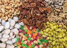 Abundance of a variety of nuts. Cashew, pistachios, marmalade, walnuts, pecans - a healthy food rich in proteins. Royalty Free Stock Photography