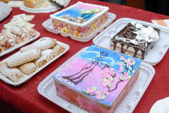 The abundance of a variety of sweets catering service sweet table. The abundance of a variety of sweets and cakes, catering service sweet table Stock Photos