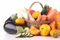Abundance of vegetable. Wicker basket with vegetable on white Stock Photos
