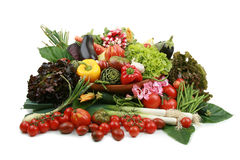 Abundance of vegetables. In wicker basket, on white background royalty free stock photo