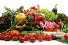 Abundance of vegetables. In wicker basket, on white background royalty free stock photos