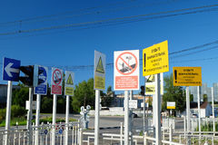 Abundance of warning labels and signs. Lomonosov, Russia: the abundance of warning labels and signs at the railway crossing Stock Image