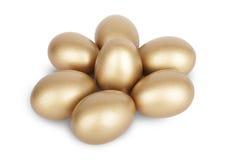Abundancia de los ahorros de los huevos de jerarquía del oro Foto de archivo