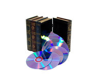 Abundant information flows. Large wooden block hollowed and carved to resemble a book pouring out a group of DVDs giving the impression that both books and royalty free stock photos