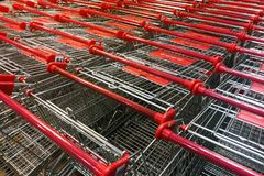 Abundant shopping cart trolley ready for use at supermarket. Abundant shopping cart trolley ready for consumers at supermarket stock photo